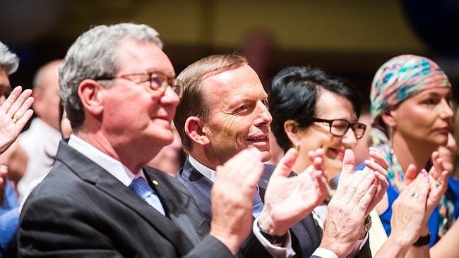 Former Foreign Affairs Minister Alexander Downer, Prime Minister Tony Abbott, SA Deputy Opposition Leader Vickie Champan and Steven Marshall's sister Kerrin Barreau applaud the Liberals' SA leader. Picture Tom Huntley