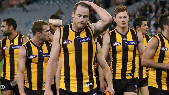 Jarryd Roughead leads the Hawks off the MCG after the loss to the Cats. Picture: Wayne Ludbey