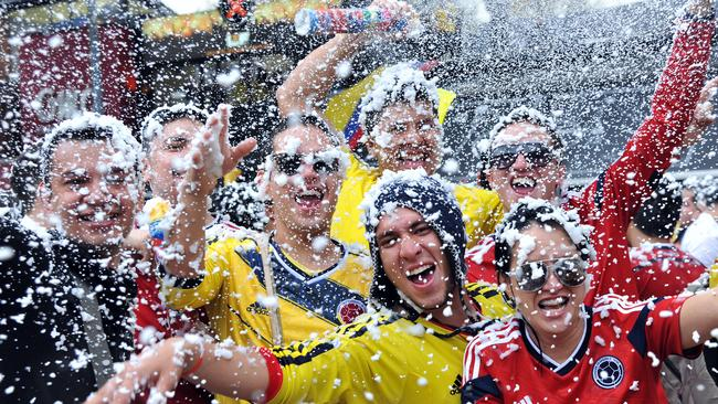Frothin: Colombian fans celebrate the victory.