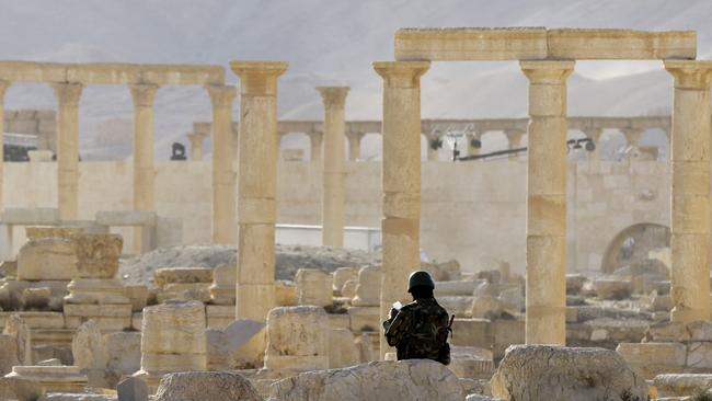 A member of the Syrian army patrols the ancient Syrian city of Palmyra in May amid reports of looting after the city was recaptured from Islamic State jihadists. Picture: AFP/Louai Beshara