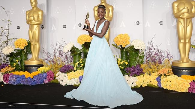 Lupita clutches her first Academy Award, given for her incredible performance in 12 Years A Slave. Picture: Getty
