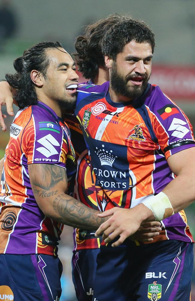 Mahe Fonua is congratulated after scoring a try.