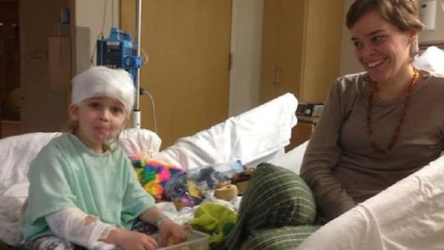 Garnett-Paul Spears in hospital with his mother Lacey, who is accused of his murder.