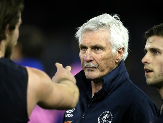 Mick Malthouse listens to Levi Casboult during a break in the win over North Melbourne. Picture: Wayne Ludbey
