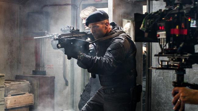 Behind the scenes shot of Jason Statham on the set of film The Expendables 3. Picture: supplied.