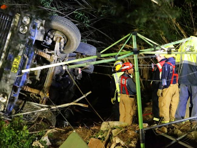 A woman has died after she was crushed by a truck which rolled down a steep driveway at Wahroonga. Crews took seven hours to remove the truck. Pics Bill Hearne