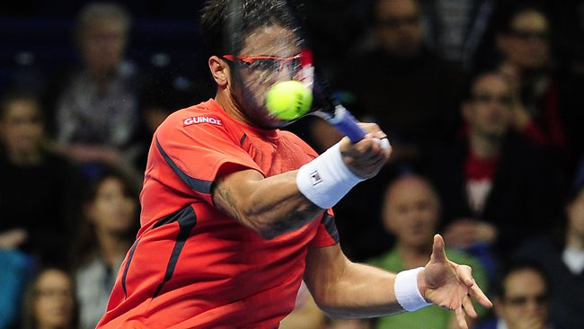 Serbia's Janko Tipsarevic returns against Roger Federer at the ATP World Tour Finals in London. Picture: Glyn Kirk