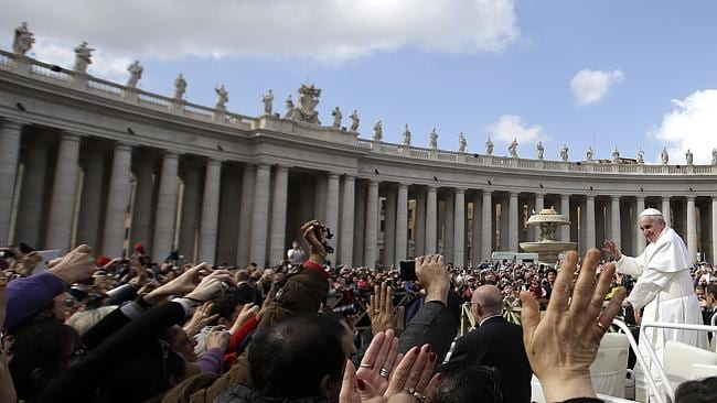 Pope Francis waves to faithful as he is driven through the crowd in his Popemobile in St. Peter's Square. The pope spilt the beans about his bouncing past to a parish in Rome. (AP / Gregorio Borgia, File)
