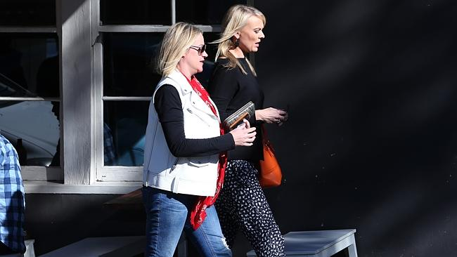 David Gyngell's wife Leila McKinnon pictured with a friend pictured leaving The Book Kitchen cafe on Devonshire Street Surry Hills. Picture: Richard Dobson