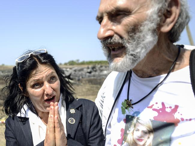 Now in Kiev ... Jerzy Dyczynsk (R) and Angela Rudhart-Dyczynski from Australia react as they arrive at the crash site of the Malaysia Airlines Flight MH17.