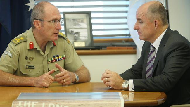 Prevention ... Assistant Minister for Defence Stuart Robert, right, with Brigadier Wayne Goodman. Picture: Gary Ramage