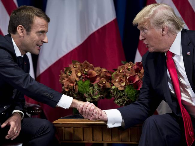 French President Emmanuel Macron (L) and US President Donald Trump shake hands before a meeting at the Palace Hotel during the 72nd session of the United Nations General Assembly. Picture: AFP