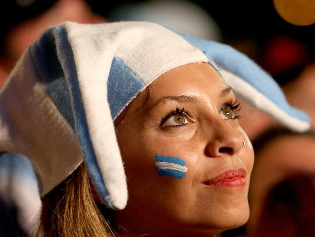 An Argentine soccer fan watches her team play against Bosnia and Herzegovina.