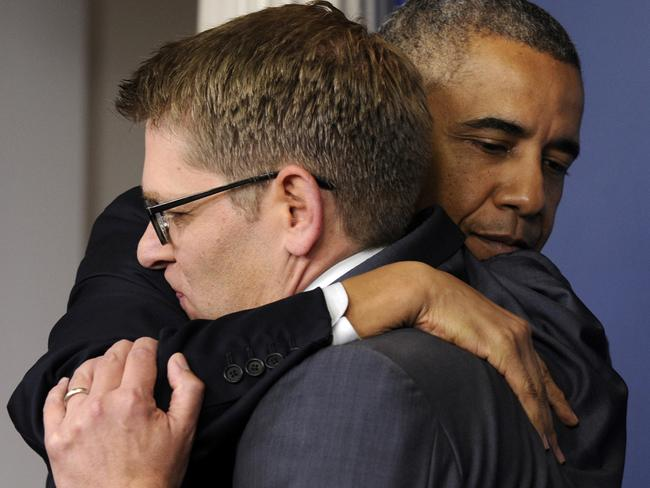 President Obama hugs it out with Jay Carney after the press secretary announced he would step down. Pic: Susan Walsh.
