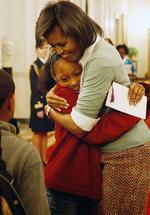 <p>Michelle Obama hugs an unidentified District of Columbia school student in the East Room at the White House in Washington during an appearence by Sweet Honey in the Rock, an African American female a cappella ensemble.</p>