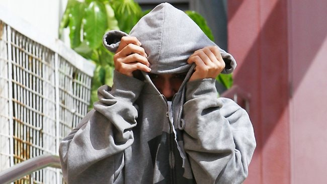 One alleged teen offender leaves court yesterday.