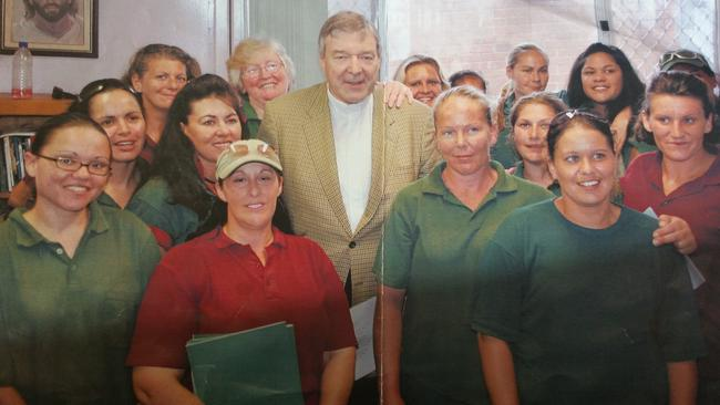 Cannibal killer Katherine Knight puts her hand on Cardinal George Pell's shoulder during a pastoral visit by the Cardinal to Silverwater Women's Prison. Picture: Candace Sutton.