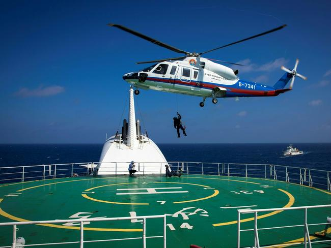 Helicopter rescue crew members practising rescue techniques during an emergency drill held by Sansha city's maritime search and rescue centre in the South China Sea near Sansha, in south China's Hainan province. Picture: AFP