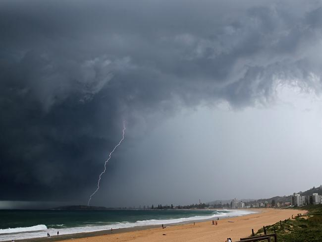 A storm cell passes over Sydney's northern beaches at Dee Why on Sunday afternoon. Picture: John Grainger