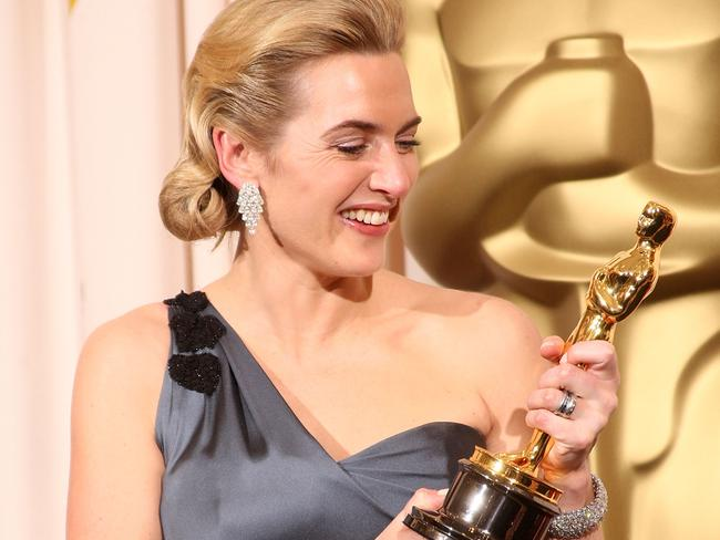 Kate Winslet poses after winning the Best Actress award for The Reader.