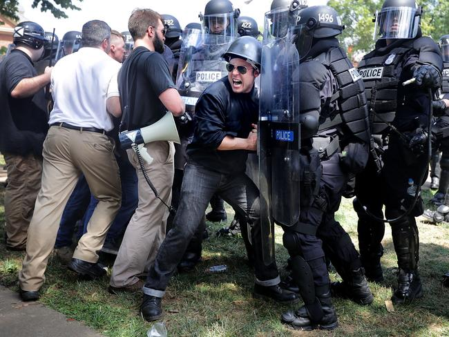 "White nationalists, Neo-Nazis and members of the ""all-right"" clashing with police as they are forced out of Emancipation Park after the ""Unite the Right"" rally was declared an unlawful gathering in Charlottesville, Virginia. Picture: AFP"