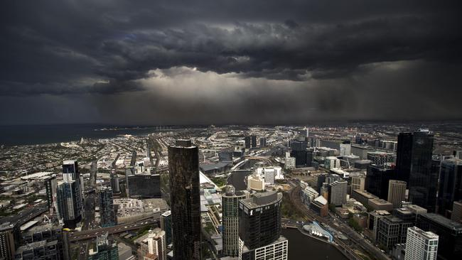 The storm front hits Melbourne. Picture Norm Oorloff