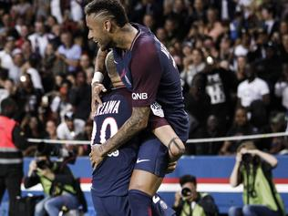 PSG's Neymar jumps over PSG's Layvin Kurzawa after scoring against Toulouse during the French League One soccer match between PSG and Toulouse at the Parc des Princes stadium in Paris, France, Sunday, Aug. 20, 2017. (AP Photo/Kamil Zihnioglu)