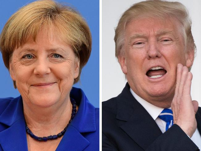 German Chancellor Angea Merkel said the fact the US pulled out of the Paris Agreement has made Europe more determined to succeed. Picture: AFP PHOTO / Don Emmert and Tobias Schwarz