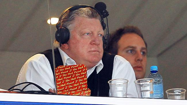 Phil Gould in the commentary box with a carton of hot chips in front of him.