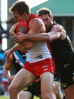 Round 13 : Jeremy Laidler is caught in a mighty tackle by Port Adelaide's Jay Schulz. Picture: Toby Zerna