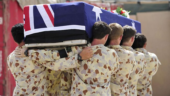 HEAVY PRICE: Australian soldiers in Afghanistan carry one of their fallen comrades. Picture: AFP
