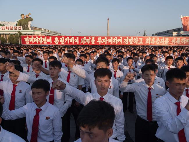 Students attend a mass rally to laud leader Kim Jong-un's denunciation of US President Donald Trump. Picture: AFP/Kim Won-jin