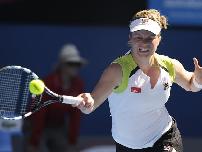 Amazing match ... Belgium's Kim Clijsters reaches for a forehand return to China's Li Na. Picture: AP Photo/Andrew Brownbill