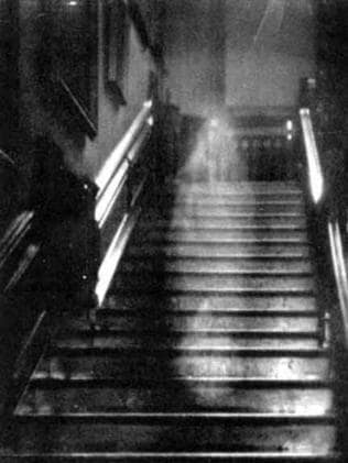 "This portrait of ""The Brown Lady"" ghost is arguably the most famous and well-regarded ghost photograph ever taken. The ghost is thought to be that of Lady Dorothy Townshend, wife of Charles Townshend, 2nd Viscount of Raynham, residents of Raynham Hall in Norfolk, England in the early 1700s. This famous photo was taken in September, 1936 by Captain Provand and Indre Shira, two photographers who were assigned to photograph Raynham Hall for Country Life magazine. The figure has been seen many times on the staircase, carrying a lantern, grinning and appearing to have her eyes gouged out. Picture: Supplied"