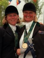 A heavily-injured Gillian Rolton with Wendy Schaeffer wearing their gold medals at Atlanta Olympic Games.