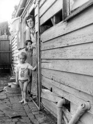 April 1977: Elizabeth Thompson with her two children, Paul and Jane, who lived in the Thompson St, Kensington, described by the Tenants' Union as one of the worst houses they'd ever seen. Picture: Herald sun Image Library
