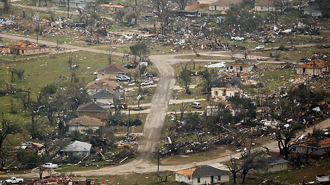 This aerial photo shows a neighborhood with extensive damage caused by Wednesday's tornado in Granbury, Texas on Thursday, May 16, 2013. Ten tornadoes touched down in several small communities in Texas overnight, leaving at least six people dead, dozens injured and hundreds homeless. Emergency responders were still searching for missing people Thursday afternoon. (AP Photo/The Dallas Morning News, G.J.McCarthy) MANDATORY CREDIT; MAGS OUT; TV OUT; INTERNET USE BY AP MEMBERS ONLY; NO SALES