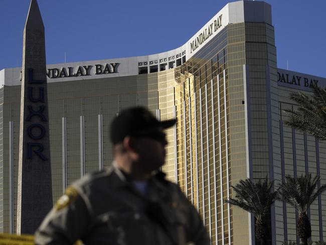 A Las Vegas police officer stands by a blocked off area near the Mandalay Bay casino in Las Vegas, two days after the October 1 shooting which left at least 58 people dead. Picture: John Locher/AP