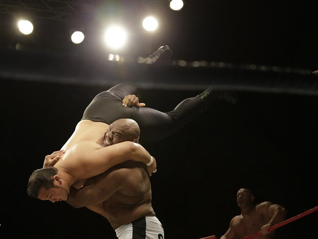 "Bob ""The Beast"" Sapp lifts his opponent during the exhibition match in front of about 15,000 people."