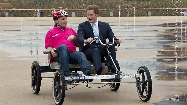 """""""I love it"""" ... Prince Harry explores Queen Elizabeth Olympic Park on four wheels. Pictur"""