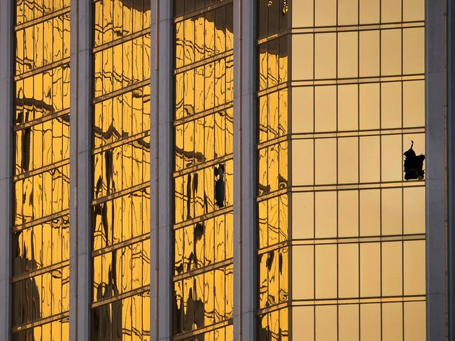 A broken window on the 32nd floor of the Mandalay Bay Resort and Casino where Paddock opened fire on concertgoers below. Picture: Drew Angerer/Getty Images/AFP