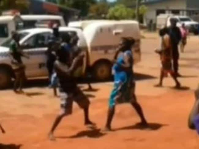 Two women throw punches in Aurukun, a Top End community where violence is common.