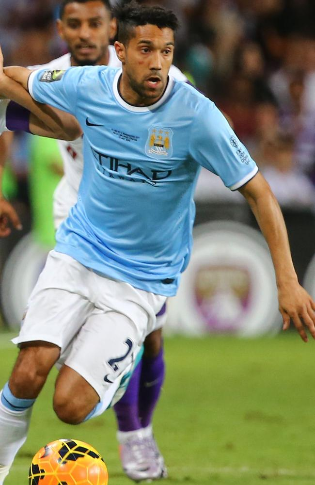 Manchester City's Gael Clichy sporting the team's famous sky blue shirt.