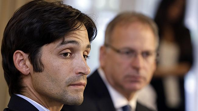 Plaintiff Michael Egan, left, with his attorney, Jeff Herman take questions from to the media during a news conference in Beverly Hills, Calif., Thursday, April 17, 2014.