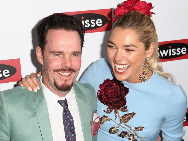 Ashley Hart shares a laugh with actor Kevin Dillon at the Swisse Marquee on Oaks Day. Picture: Cameron Spencer/Getty Images.