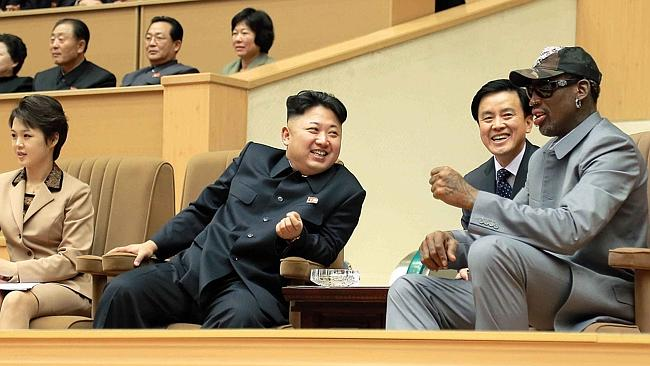 This photo taken on January 08, 2014 and released by North Korea's official Korean Central News Agency (KCNA) on January 9, 2014 shows North Korean dictator Kim Jong-Un (C), his wife Ri Sol-Ju (L) and former US basketball star Dennis Rodman (R) watching a basketball game between former NBA players and North Korean players at Pyongyang Gymnasium./