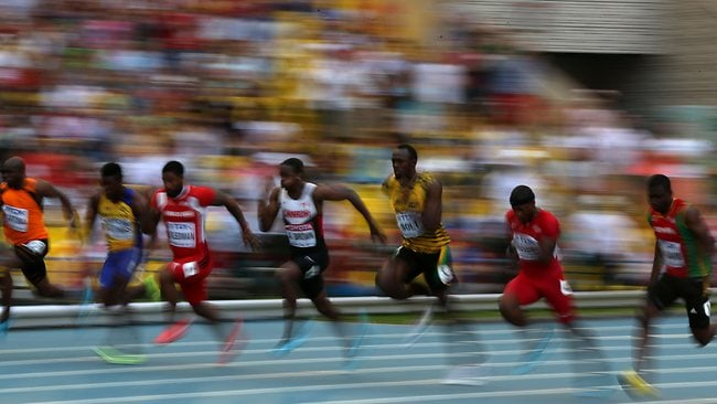 Jamaica's Usain Bolt (C) races during the men's 100 metres semi-final at the 2013 IAAF World Championships at the Luzhniki stadium in Moscow.