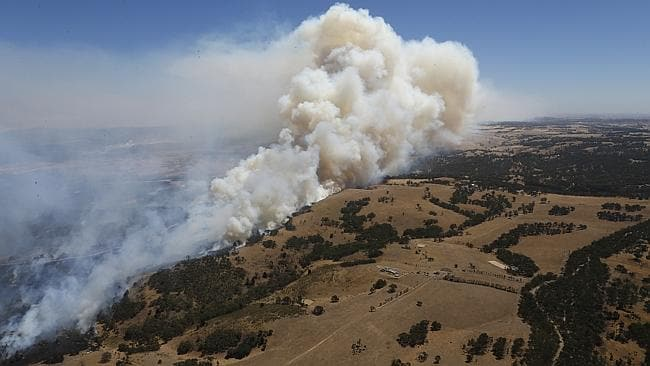 Smoke billows over the Wallan area. Picture: David Caird