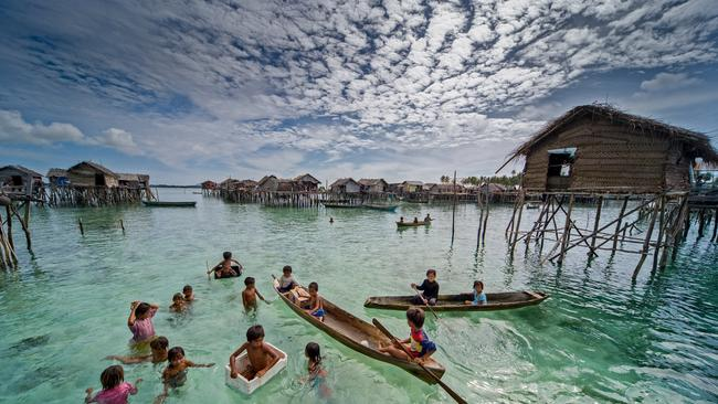 Bajau people of malaysia live at sea for Aaa fish house