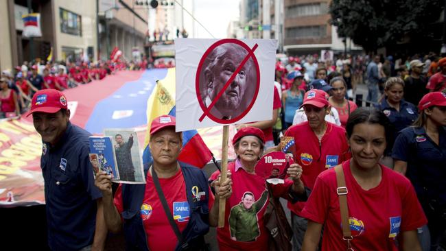 Government supporters take to the streets in Caracas to slam President Trump after he denounced President Maduro's rule. Picture: Ariana Cubillos